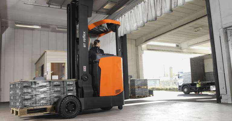 Large reflex reach truck on its way outdoors