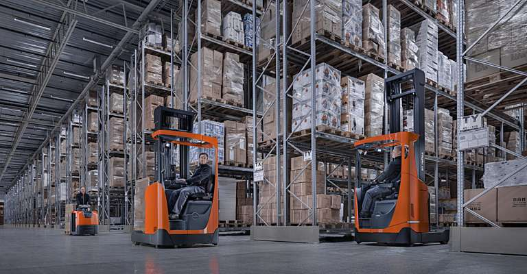 Reflex reach trucks in large warehouse