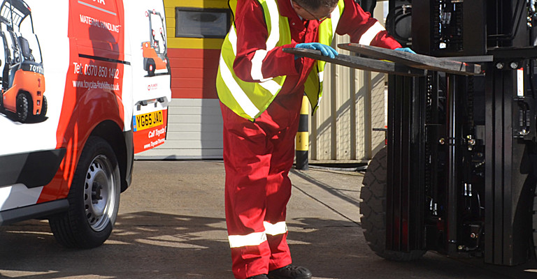 Thorough Examination technician carrying out thorough examination on a forklift truck