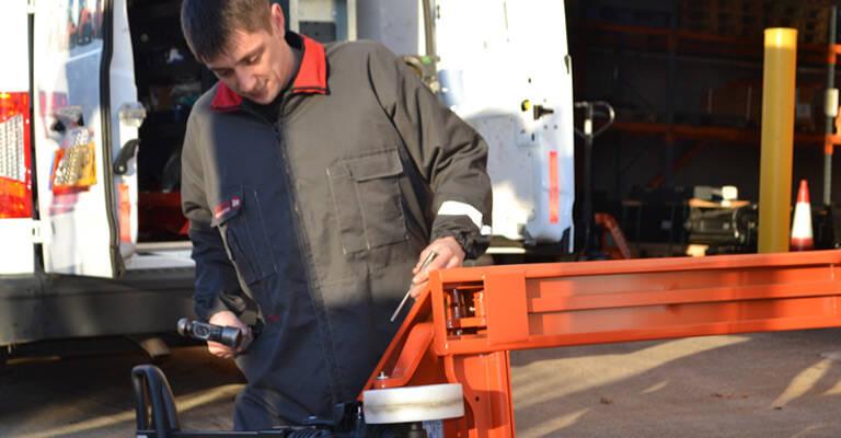 Technician servicing a hand pallet truck