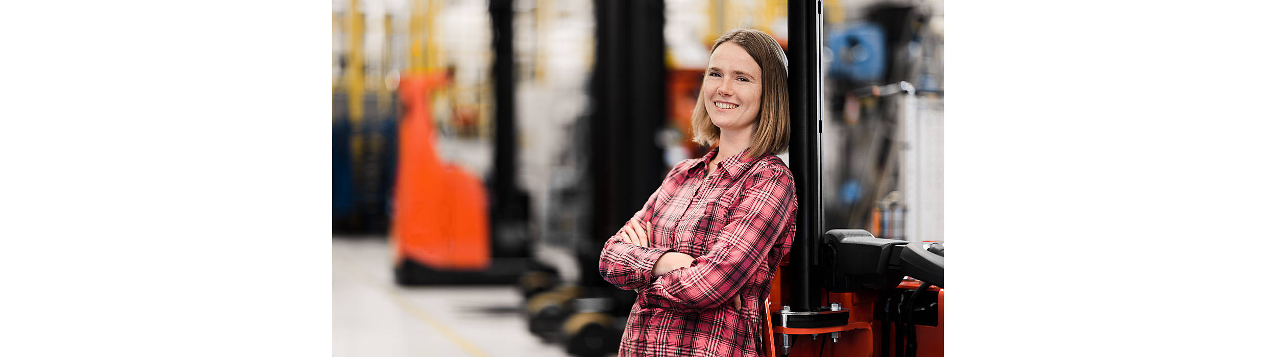 Toyota material handling employee standing at forklift
