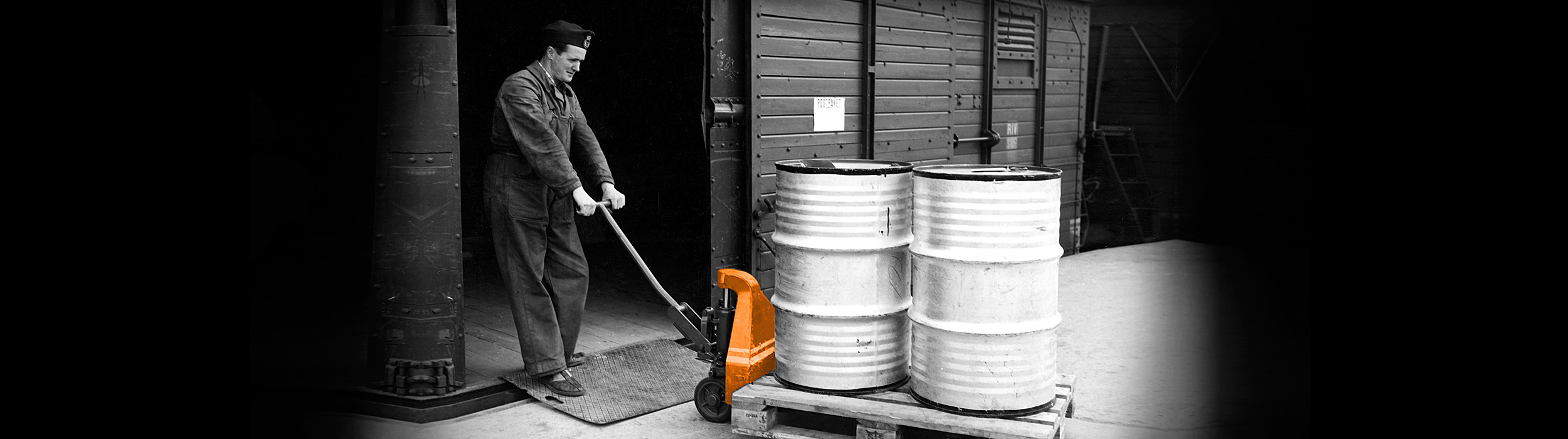 History image of man using a hand pallet truck