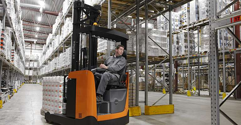 Reach truck in warehouse